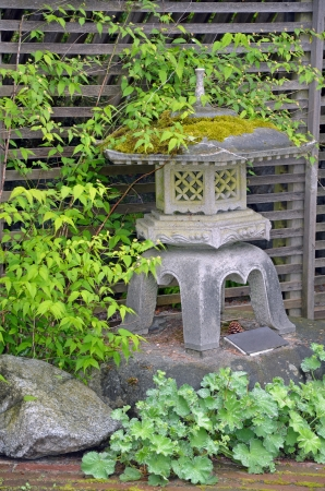 Small japanese shrine covered with moss in the garden Stock Photo - 19943200