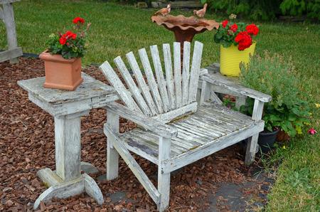 garden bench: Old weathered wooden garden bench Stock Photo