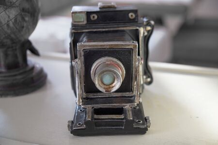 old camera on a white background Imagens