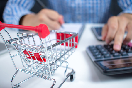 Businessmen are figuring out the stock and price. For online shopping cart with a calculator. Stock Photo