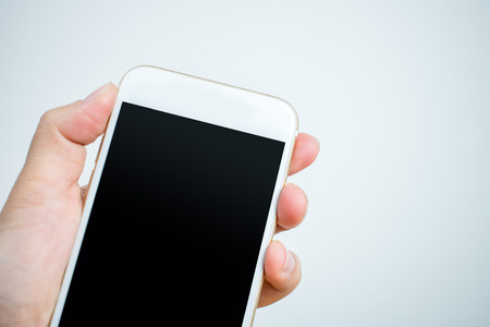 Close-up shots of hands holding a white phone. Stock fotó