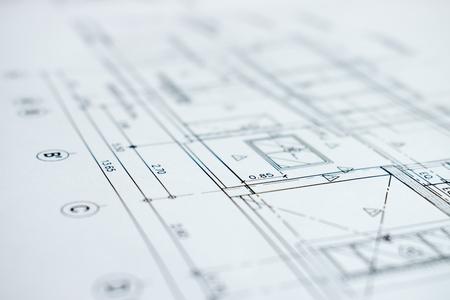 Close-up foto met details van bouwplannen.