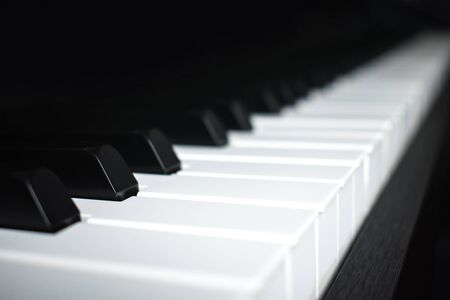Close-up image of the piano with black and white tones. 版權商用圖片