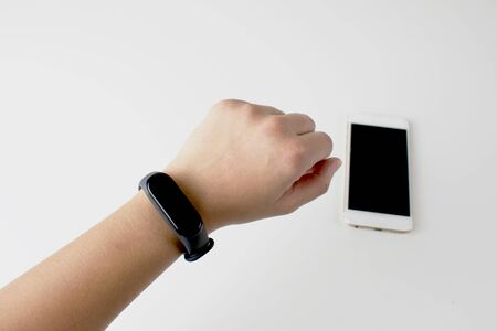 Smart watch in the wrist of women isolate white background. Imagens