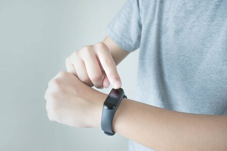 People are using a smart watch to check the heart rate.