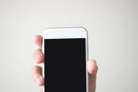Close-up, Hands holding a smart phone with a black screen Imagens