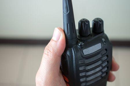 Close up to the hand using radio communication.