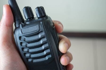Hand holding radio communication, close up.