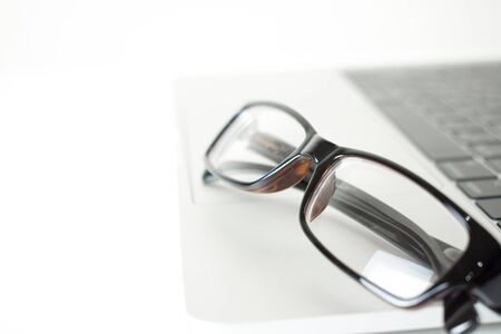Close-up eyeglasses on a laptop computer.