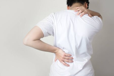 Asian people have shoulder pain to the back. Using hands to hold on the shoulders and spines.