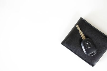 Car keys on the wallet isolated on white background with space on the left.