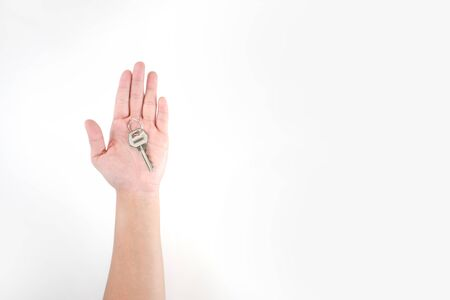The image in the hands of Asian people has keys on a white background.