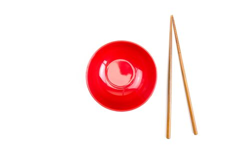 Red bowl with chopsticks and isolated on a white background. 版權商用圖片
