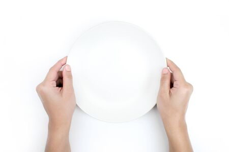 The hand is holding the plate in the top view. Isolated white background. 版權商用圖片