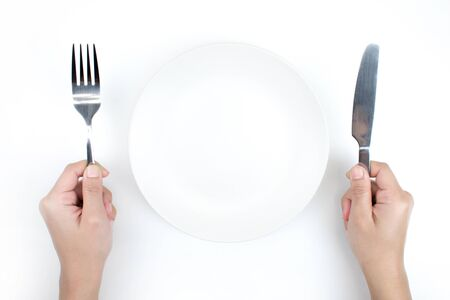 Plate and spoon in the top view, Isolated white background.