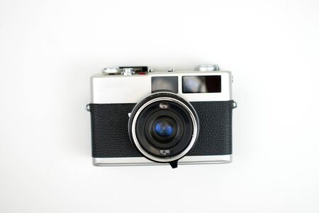 The top view of a film camera on a white background. Isolated background.
