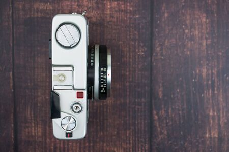 Flat lay of vintage camera on an old wooden background. Isolated background. Top view.