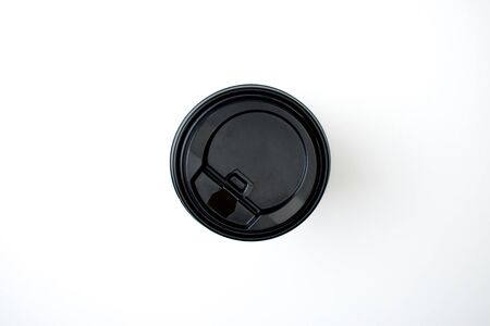 Black paper coffee cup top view white background. Isolated.