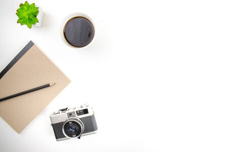 Flat lay, Top view with film camera, notebook and coffee on a white desk. With copy space. 版權商用圖片