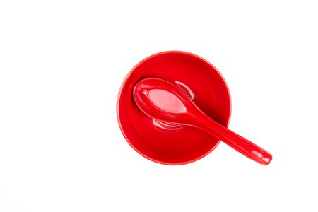Top view, spoon in a red bowl. Isolated background. 版權商用圖片