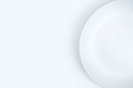 Empty plate on a white background with copy space. 版權商用圖片