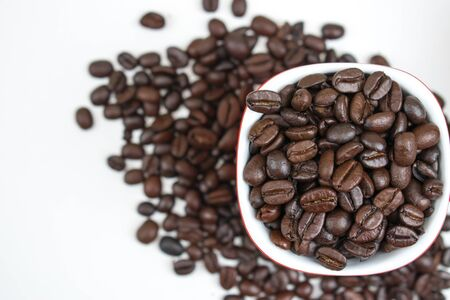 Close-up texture of coffee beans in a glass on a white background. 版權商用圖片