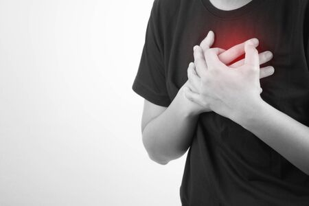 Asian people have a heart attack on a white background. Isolated background. Health and Medical Concept