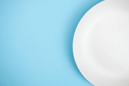 A white rice dish a blue background. With copy space. Top view.