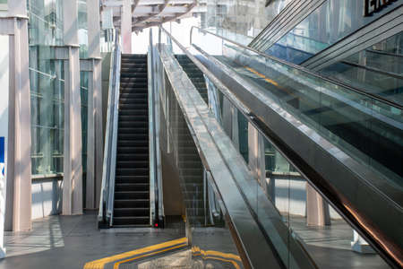 Escalators in shopping centers or department stores.