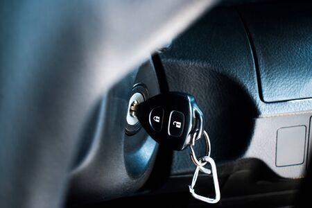Car keys start the combustion of modern cars. Car key in keyhole.