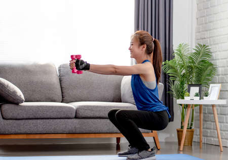 Asian women exercise legs at home. Workout from home. Foto de archivo