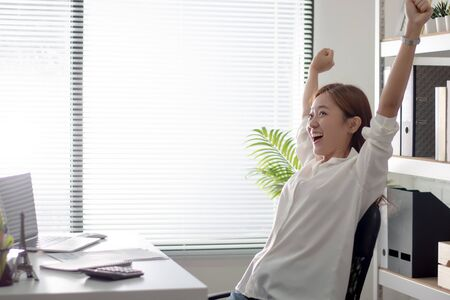Asian working women. She is happy and feels relaxed from work.
