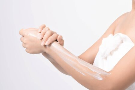 Women use body lotion on her arms.