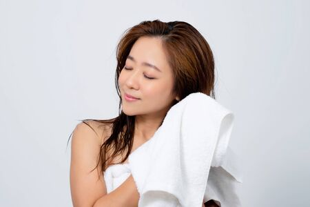 Happy Asian women are using a towel to dry their hair.