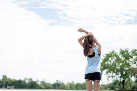 Asian women runner stretch before exercise.