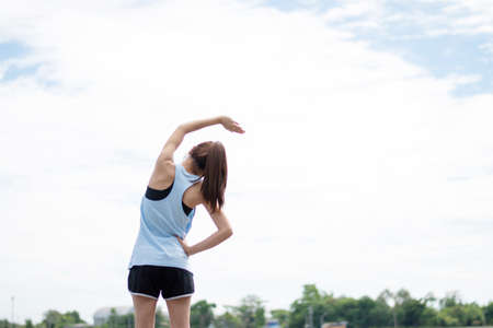 Woman stretch before exercise in the morning.