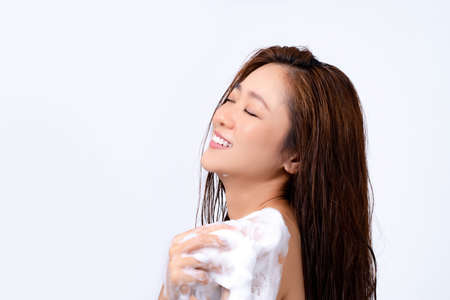 Asian beautiful women being happy with the shower on a white background. Reklamní fotografie