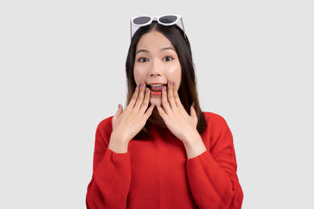 Beautiful Asian woman wearing fashionable glasses was shocked and surprised, isolated on white background.