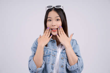 Shocked Asian women at a special promotion, On a white background.