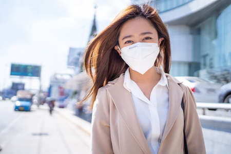 Asian women going to work and wearing N95 masks to prevent PM 2.5 dust.