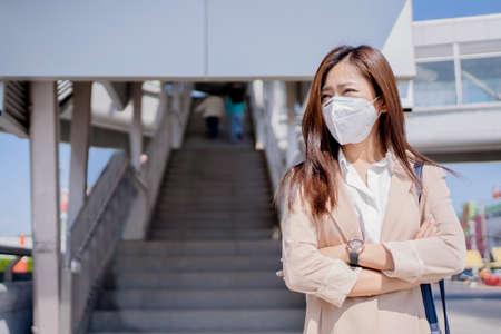 Asian women going to work in the city center She wears a N95 mask to prevent PM2.5 dust.