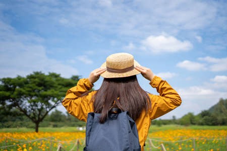 Young asian women tourists. She felt relaxed and happy in the sunflower field.