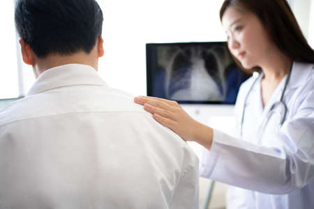 Asian female doctor encouragement examination and x-ray of a patient.