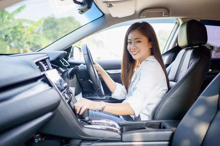 Asian woman smile and enjoy driving on vacation.