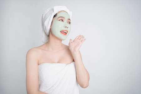 Asian woman is facial mask sheet. She was excited and shocked.