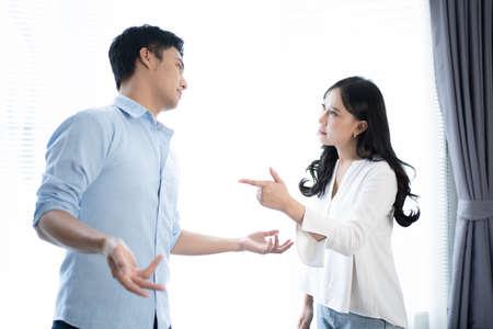 Asian couples quarrel at home.