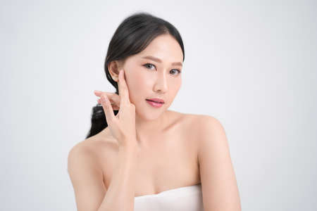 Youthful bright skin of a beautiful Asian woman. Isolated on white background.