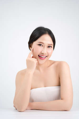 Asian beautiful women have a youthful face. She pointed at her bright, clean skin. Beauty concept