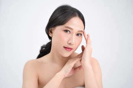 Asian beautiful woman skin care, bright and youthful. Beauty concept. Isolated from the white background.