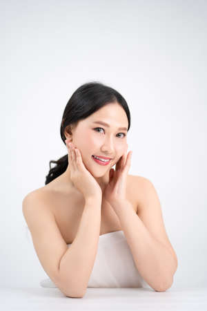 Beautiful young Asian woman have a bright and youthful face. She is happy and smiling.